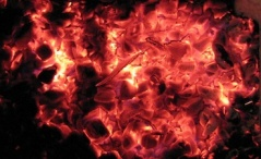 Glowing embers in a wood stove