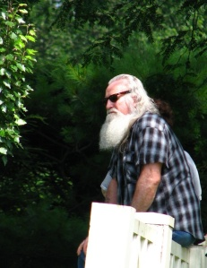 Santa listening to a summer concert on Carding green