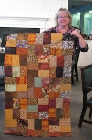 Denise finishes a quilt top