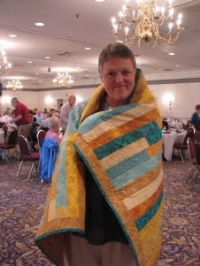 Olivia was one of the recipients who smiled all day. Her quilt was made by Joanne Shapp.